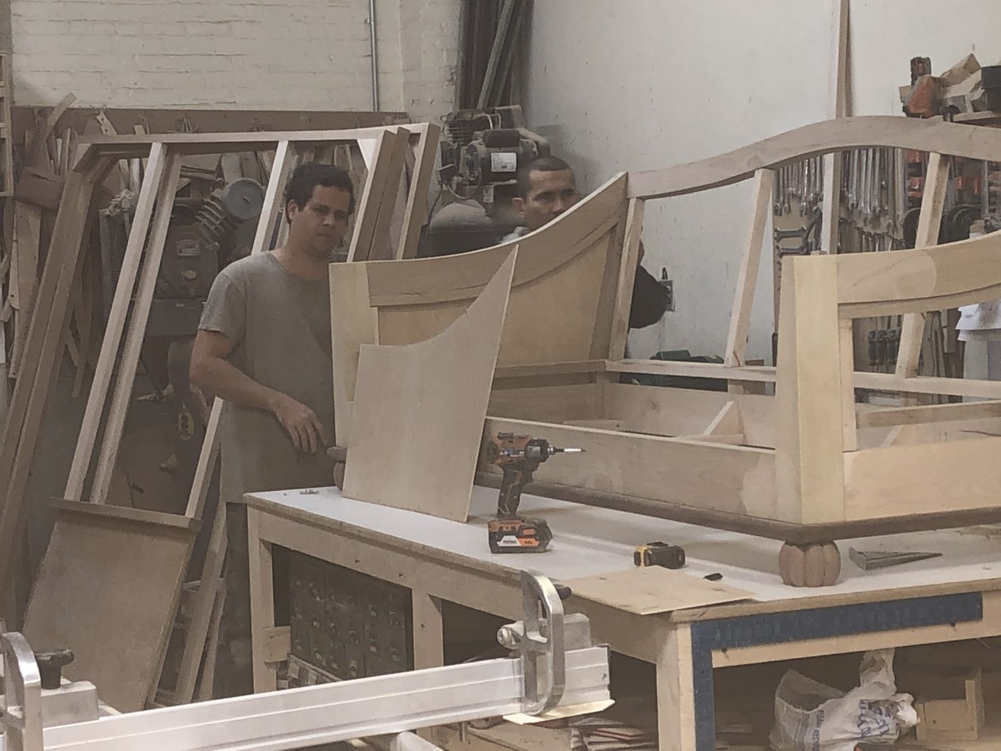 A man working with plywood